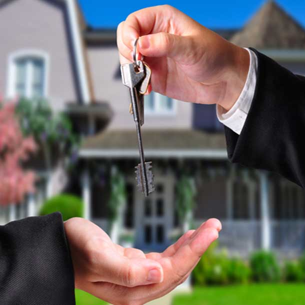 mortgage broker giving key to house in Victoria BC